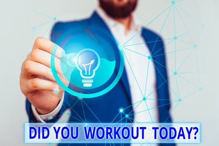 Text sign showing Did You Workout Today. Business photo text asking if made session physical exercise Male human wear formal work suit presenting presentation using smart device 版權商用圖片 - 137841457