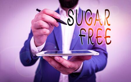 Handwriting text Sugar Free. Conceptual photo containing an artificial sweetening substance instead of sugar Businessman pointing with pen in empty copy space 写真素材