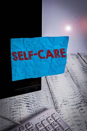 Handwriting text Self Care. Conceptual photo the practice of taking action to improve one s is own health Notation paper taped to black computer monitor screen near white keyboard Stock fotó