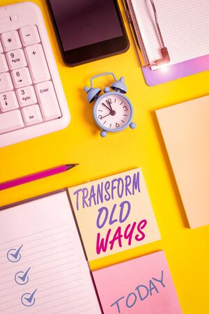 Writing note showing Transform Old Ways. Business concept for replace it with new methods Alternatives new solution White paper with copy space with paper clips clock and pc keyboard