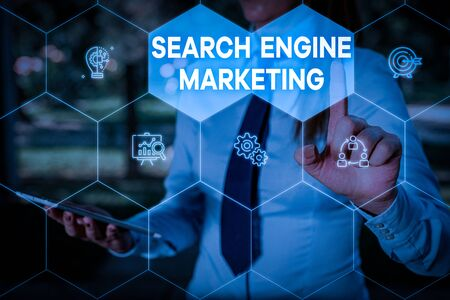 Handwriting text Search Engine Marketing. Conceptual photo promote Website visibility on searched result pages Woman wear formal work suit presenting presentation using smart device