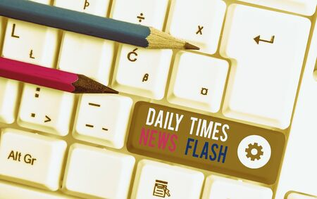 Handwriting text writing Daily Times News Flash. Conceptual photo fast response to actions happened in article way White pc keyboard with empty note paper above white background key copy space