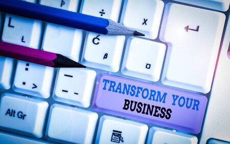 Handwriting text Transform Your Business. Conceptual photo Modify energy on innovation and sustainable growth White pc keyboard with empty note paper above white background key copy space Фото со стока