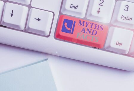Text sign showing Myths And Facts. Business photo showcasing Oppositive concept about modern and ancient period White pc keyboard with empty note paper above white background key copy space