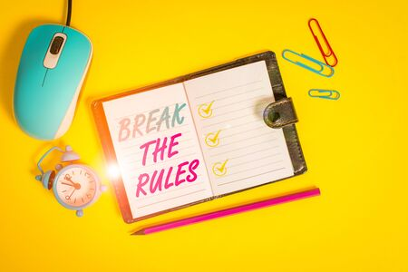 Word writing text Break The Rules. Business photo showcasing Make changes do everything different Rebellion Reform Locked diary sheets clips marker mouse alarm clock colored background