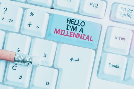 Writing note showing Hello I M A Millennial. Business concept for demonstrating reaching young adulthood in current century White pc keyboard with note paper above the white background