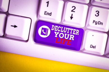 Writing note showing Declutter Your Life. Business concept for To eliminate extraneous things or information in life White pc keyboard with note paper above the white background 版權商用圖片
