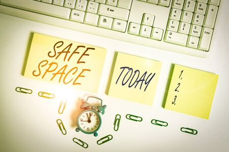 Handwriting text Safe Space. Conceptual photo a place or room in which you are protected from harm or danger Empty orange square papers and clock by the pc keyboard with copy space