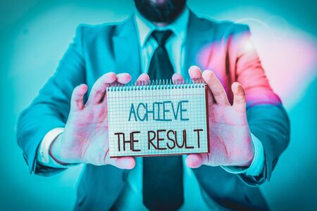Word writing text Achieve The Result. Business photo showcasing Receive successful result from hard work make you happy Man holds empty paper with copy space in front of him Copy Space