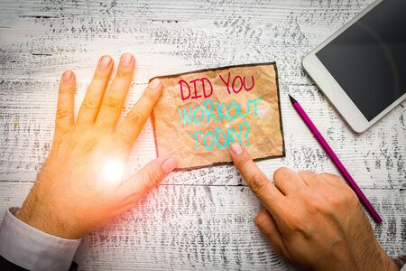 Handwriting text writing Did You Workout Today. Conceptual photo asking if made session physical exercise Hand hold note paper near writing equipment and modern smartphone device