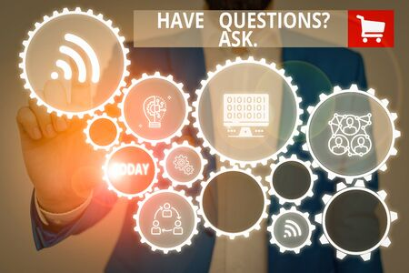 Text sign showing Have Questions Question Ask. Business photo showcasing asking someone respond you with feedback Male human wear formal work suit presenting presentation using smart device Фото со стока