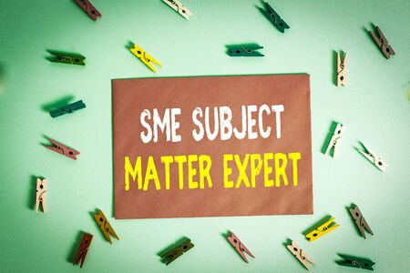 Conceptual hand writing showing Sme Subject Matter Expert. Concept meaning Authority in a particular area or topic Domain Colored clothespin rectangle shaped paper blue background