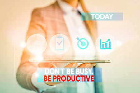 Conceptual hand writing showing Don T Be Busy Be Productive. Concept meaning Work efficiently Organize your schedule time Female human wear formal work suit presenting smart device