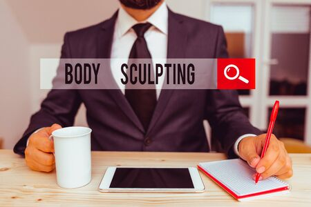 Word writing text Body Sculpting. Business photo showcasing activity of increasing the body s is visible muscle tone Male human wear formal clothes present presentation use hi tech smartphone Zdjęcie Seryjne