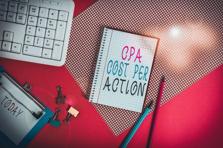 Conceptual hand writing showing Cpa Cost Per Action. Concept meaning Commission paid when user Clicks on an Affiliate Link Writing equipments and computer stuff placed on plain table