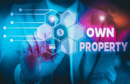 Conceptual hand writing showing Own Property. Concept meaning Things that you own and can take it with you Movable Tangible Male wear formal suit presenting presentation smart device Zdjęcie Seryjne