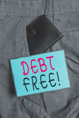 Conceptual hand writing showing Debt Free. Concept meaning does not owning any money or things to any individual or companies Small wallet inside trouser front pocket near notation paper