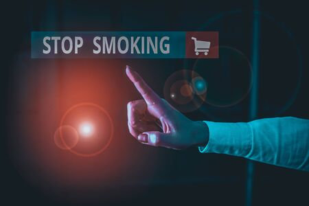 Word writing text Stop Smoking. Business photo showcasing the process of discontinuing or quitting tobacco smoking Finger pointing in the Dark with hand pointing in the copy space