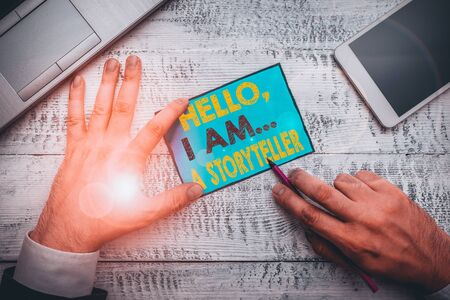 Writing note showing Hello I Am A Storyteller. Business concept for introducing yourself as novels article writer Foto de archivo