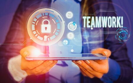 Writing note showing Teamwork. Business concept for combined action of group especially when effective and efficient Picture photo network scheme with modern smart device Reklamní fotografie