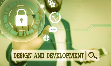 Text sign showing Design And Development. Business photo text Defining the Specification of Products and Services Male human wear formal work suit presenting presentation using smart device