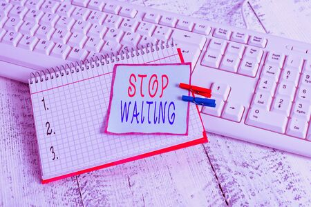 Conceptual hand writing showing Stop Waiting. Concept meaning do not stay in the same place doing nothing Move forward notebook reminder clothespin with pinned sheet light wooden 版權商用圖片 - 137852082
