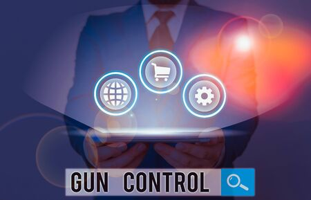 Writing note showing Gun Control. Business concept for legal measure intended to restrict the possession of guns Zdjęcie Seryjne