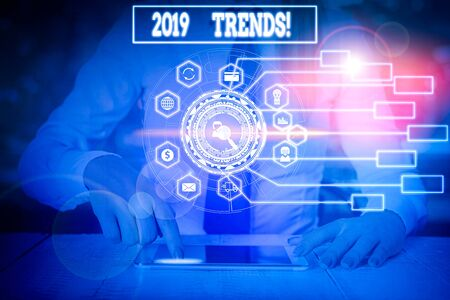Writing note showing 2019 Trends. Business concept for general direction in which something is developing or changing Woman wear formal work suit present using smart latest device Zdjęcie Seryjne