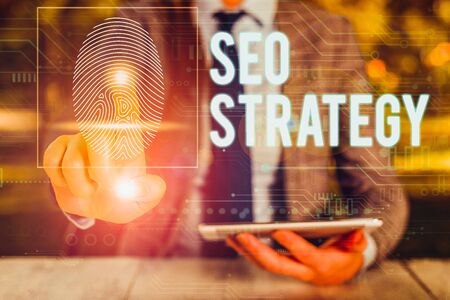 Text sign showing Seo Strategy. Business photo text procedures that aim to increase the visibility of a website Woman wear formal work suit presenting presentation using smart device Zdjęcie Seryjne