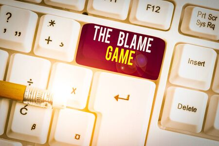 Text sign showing The Blame Game. Business photo text A situation when showing attempt to blame one another White pc keyboard with empty note paper above white background key copy space