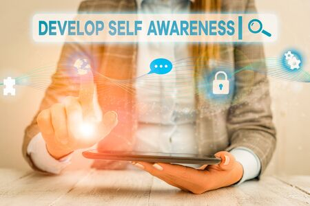Text sign showing Develop Self Awareness. Business photo showcasing increase conscious knowledge of own character Female human wear formal work suit presenting presentation use smart device