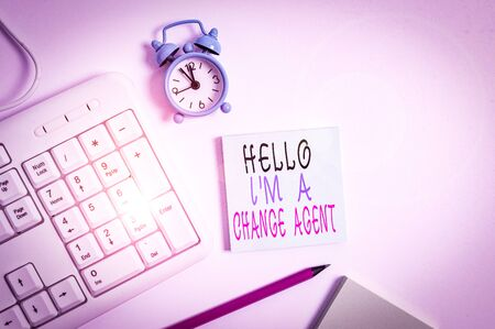 Conceptual hand writing showing Hello I M A Change Agent. Concept meaning Promoting and enabling difference evolution new Keyboard with empty note paper and pencil white background