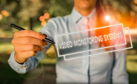 Word writing text Video Monitoring Systems. Business photo showcasing Surveillance Transmit capture Image to Digital Link Woman in a blue business shirts pointing with her finger into empty space