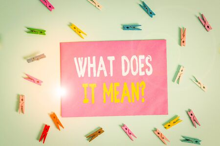 Conceptual hand writing showing What Does It Mean Question. Concept meaning Give me the meaning of something Definition Colored clothespin rectangle shaped paper blue background