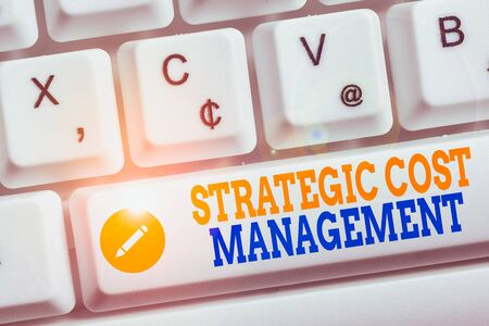 Writing note showing Strategic Cost Management. Business concept for Reduce total Expenses while improving operation Keyboard with note paper on white background key copy space
