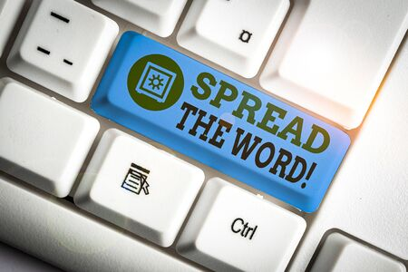 Text sign showing Spread The Word. Business photo text share the information or news using social media White pc keyboard with empty note paper above white background key copy space