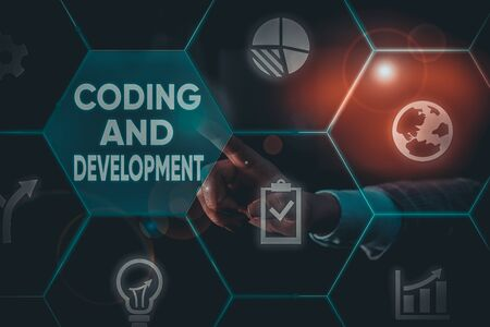 Writing note showing Coding And Development. Business concept for Programming Building simple assembly Programs Male human wear formal suit presenting using smart device