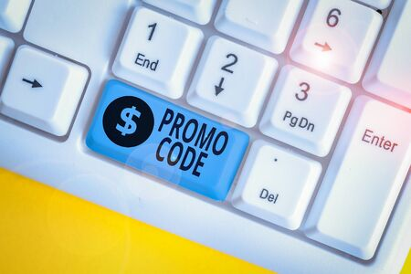 Writing note showing Promo Code. Business concept for digital numbers that give you good discount on certain product White pc keyboard with note paper above the white background Stock Photo