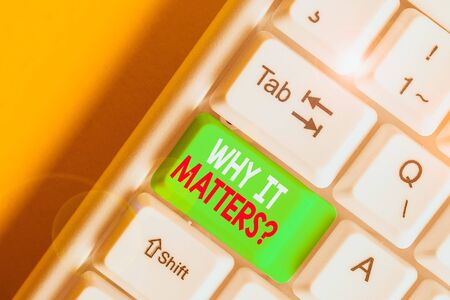 Writing note showing Why It Matters Question. Business concept for most important thing to be done when involved in situation White pc keyboard with note paper above the white background