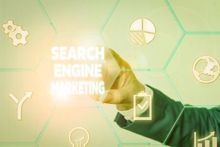 Handwriting text Search Engine Marketing. Conceptual photo promote Website visibility on searched result pages Male human wear formal work suit presenting presentation using smart device Stock Photo