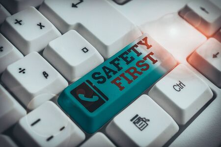 Text sign showing Safety First. Business photo text said to mean that it is best to avoid any unnecessary risks White pc keyboard with empty note paper above white background key copy space
