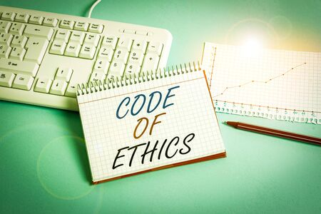 Text sign showing Code Of Ethics. Business photo showcasing Moral Rules Ethical Integrity Honesty Good procedure Paper blue desk computer keyboard office study notebook chart numbers memo