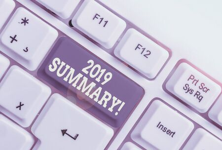 Text sign showing 2019 Summary. Business photo showcasing summarizing past year events main actions or good shows White pc keyboard with empty note paper above white background key copy space