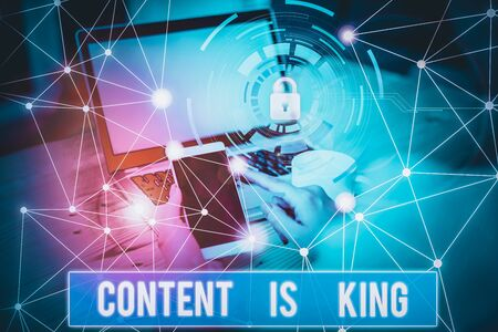 Conceptual hand writing showing Content Is King. Concept meaning marketing focused growing visibility non paid search results Picture photo network scheme with modern smart device Фото со стока