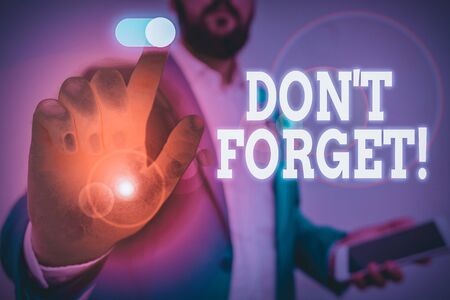 Handwriting text writing Don T Forget. Conceptual photo used to remind someone about important fact or detail Male human wear formal work suit presenting presentation using smart device
