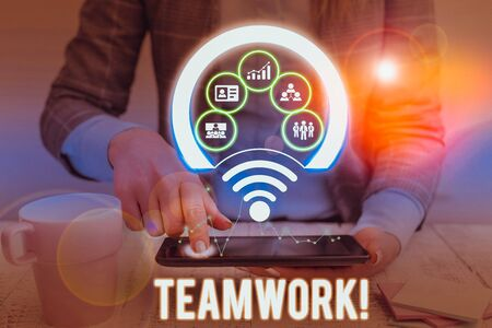 Conceptual hand writing showing Teamwork. Concept meaning combined action of group especially when effective and efficient Picture photo network scheme with modern smart device