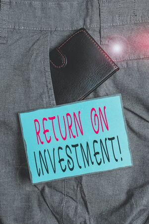 Conceptual hand writing showing Return On Investment. Concept meaning perforanalysisce measure used evaluate efficiency of investment Small wallet inside trouser front pocket near notation paper Archivio Fotografico