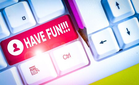 Word writing text Have Fun. Business photo showcasing wish somebody good and enjoyable time when they do something White pc keyboard with empty note paper above white background key copy space Stock Photo