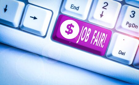 Conceptual hand writing showing Job Fair. Concept meaning event in which employers recruiters give information to employees White pc keyboard with note paper above the white background