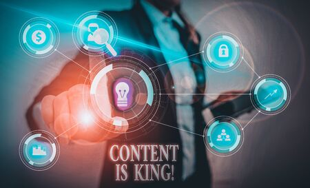 Text sign showing Content Is King. Business photo text marketing focused growing visibility non paid search results Woman wear formal work suit presenting presentation using smart device